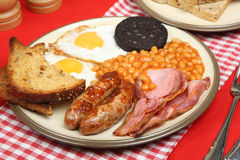 Full English Fried Breakfast. English cooked breakfast with black pudding, baked beans and fried bread Stock Image