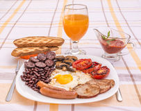 Full English fried breakfast with bacon, egg, sausages, black pudding, mushrooms Royalty Free Stock Photos
