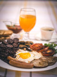 Full English fried breakfast with bacon, egg, sausages, black pudding, mushrooms Stock Image