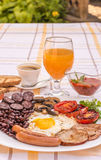 Full English fried breakfast with bacon, egg, sausages, black pudding, mushrooms Royalty Free Stock Photo