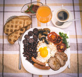 Full English fried breakfast with bacon, egg, sausages, black pudding, mushrooms Stock Images