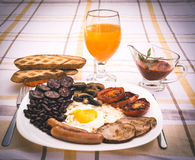 Full English fried breakfast with bacon, egg, sausages, black pudding, mushrooms Royalty Free Stock Image