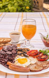 Full English fried breakfast with bacon, egg, sausages, black pudding, mushrooms Royalty Free Stock Images