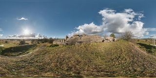 Full 360 equirectangular equidistant spherical panorama as background. Approaching storm on the ruined military fortress of the. First World War. Skybox for VR royalty free stock photography