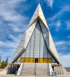 Full on Facade of the Chapel at the United States Air Force Academy. A wispy cloud azure blue sky shrouds the facade of the Air Force Academy Chapel in Colorado stock photos