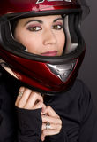 Motorcycle Rider Adjusts Red Full Face Helmet stock photos