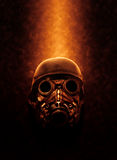 Full Face Gas Mask in Orange Lighting. Still Life of Gas Mask and Military Helmet Lit from Above with Warm Fiery Lighting - Concept Image of Full Face Gas Mask Royalty Free Stock Images