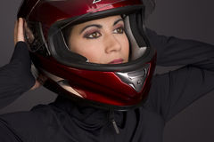 Red Full Face Helmet on Attrace Womans Head Royalty Free Stock Photo