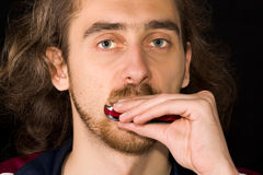 Full face portrait of man playing harmonica Stock Photos