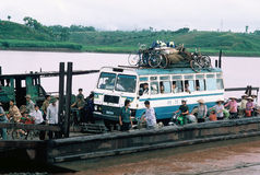 Full Ferry in Viet Nam. Crowded ferry with buses crossing a river in northern Vietnam Stock Image