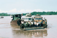 Full Ferry in Viet Nam. Crowded ferry with buses crossing a river in northern Vietnam Royalty Free Stock Image