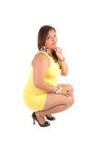 Full figured girl crouching. Stock Images