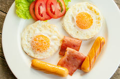 Full fill your energy in the beginning of the day with american. Eggs, ham, sausage Royalty Free Stock Photos