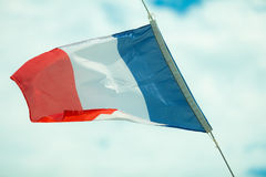 Full flag of France blue sky background Stock Photography