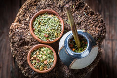 Full of flavor yerba mate with bombilla and calabash Stock Photos