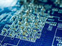 Full focus circuit board with microchips and other electronic components. Computer and networking communication technology Royalty Free Stock Images