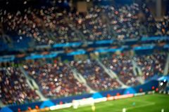 Full football soccer stadium tribunes with lights. Soft focus blurred background royalty free stock images