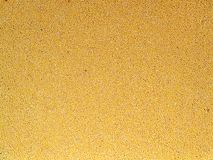 Full Frame background of raw yellow groats of millet lie evenly. Close up royalty free stock image