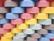 Staggered Colorful Plastic Bowls. Full Frame Background of Staggered Colorful Plastic Bowls royalty free stock photo