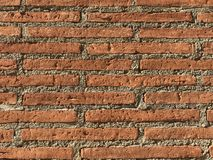 Full frame of brick and cement wall in day light. Using for background or for montage product display in commercial advertisement stock images