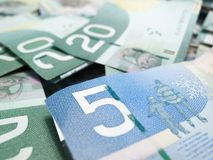 Full frame of Canadian money and focus on five. Canadian dollar bill Royalty Free Stock Photos