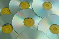 A full frame of cds. With a yellow background royalty free stock images