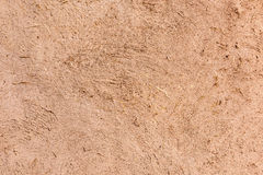 Full frame close-up of a adobe mud wall. In New Mexico. The texture and straws are visible Royalty Free Stock Image