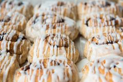 Full-frame freshly frosted cinnamon rolls in pan close-up stock images