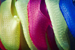 Full frame colorful pairs of slip-on water shoes background Royalty Free Stock Photography