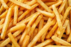 Full frame of french fries. Horizontal full frame of fresh french fries potatoes viewed from above royalty free stock photo