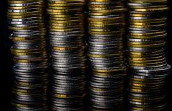 Golden and silver color coin stacks on dark background with copy space for text. Business and finance growth, saving money Stock Image