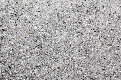 Full Frame Photo of Clear Glass Beads. A full frame photograph of clear glass seed beads with silver colored centers Royalty Free Stock Images