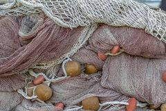 Fishing net entanglement. Full frame picture showing a tangled fishing net royalty free stock photo