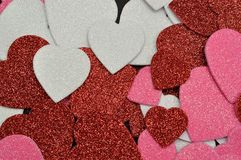 A full frame of colorful glitter hearts Stock Images