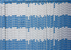 Full frame of a plastic pearl door blind and curtain on a white stock photos