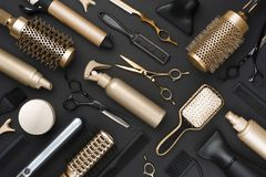 Full frame of professional hair dresser tools on black background.  royalty free stock photos
