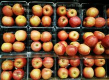 Full frame of red apples grouped and stacked on display shelves Stock Photo