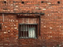 Full Frame Shot Of Brick Wall with a Rusty old window royalty free stock photo