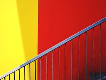 Stairway and Vivid Red and Yellow Wall Background stock photos