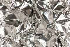 Full frame take of a sheeT of crumpled silver aluminum foil. Background royalty free stock photo