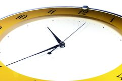 Full Frame Tilted Clock. Clock in full frame wiht slight tilt and yellow colors. The background is white stock illustration