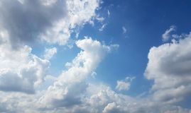 Full frame of white fluffy clouds with blue sky Stock Photography