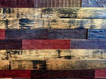 Full frame of wood planks in red, blue, and tan royalty free stock photo