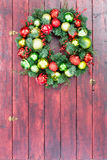 Full frame wooden stained door with holiday wreath Royalty Free Stock Photos