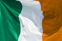 Full framed irish flag floating. In the wind exact colors stock photo