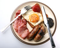 Full Fried Breakfast. A tasty plate of fried food for breakfast, isolated royalty free stock images
