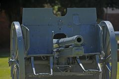 Front-on view of an Australian Army field cannon showing the barrel and steel guard, protecting the sodiers. royalty free stock images