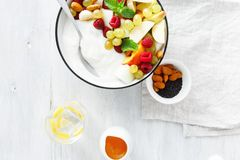 Full fruit breakfast natural yoghurt bowl Healthy food top view. Healthy food concept on white background, top view flat lay. Fruit breakfast and natural yoghurt royalty free stock photo