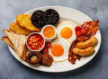 Full fry up English breakfast with fried eggs, sausages, bacon Stock Photos