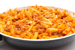 Full frying pan with macaroni bolognesa Royalty Free Stock Photos